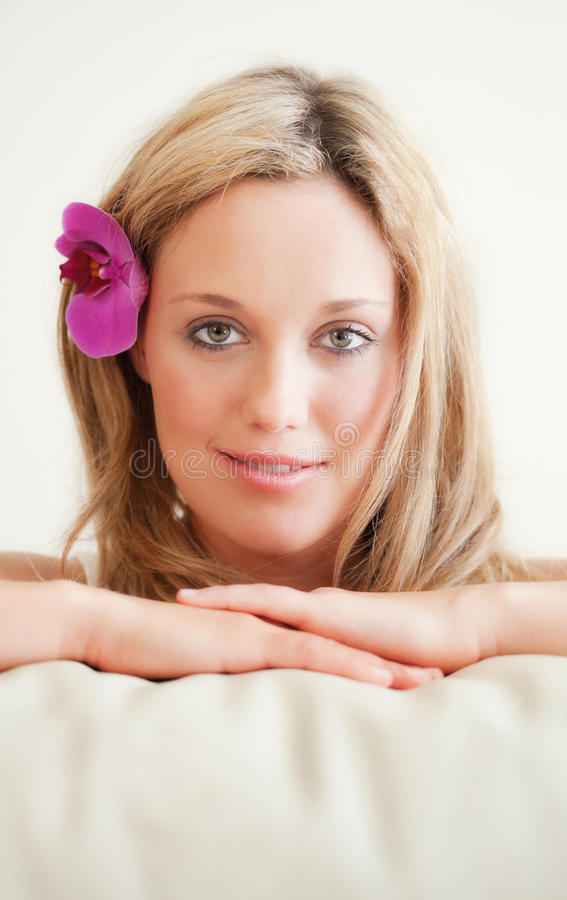 Download Pretty Young Woman With Orchid In The Hair Stock Photo - Image: 22744994