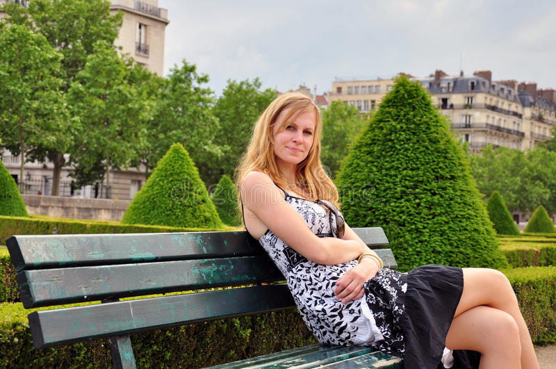Download Pretty Young Woman In The Park Stock Photo - Image of wood, paris: 34371718