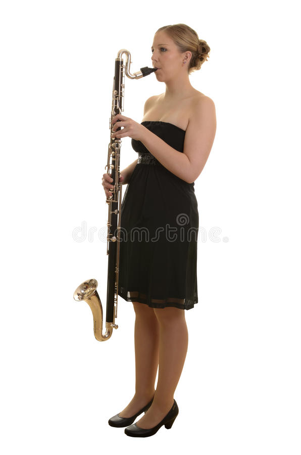 Pretty young woman playing bass clarinet stock image