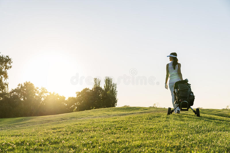 Pretty young woman playing golf. royalty free stock photo
