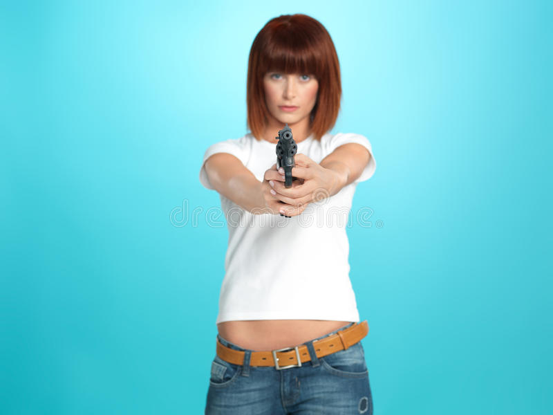 Pretty Young Woman Pointing The Gun Stock Image