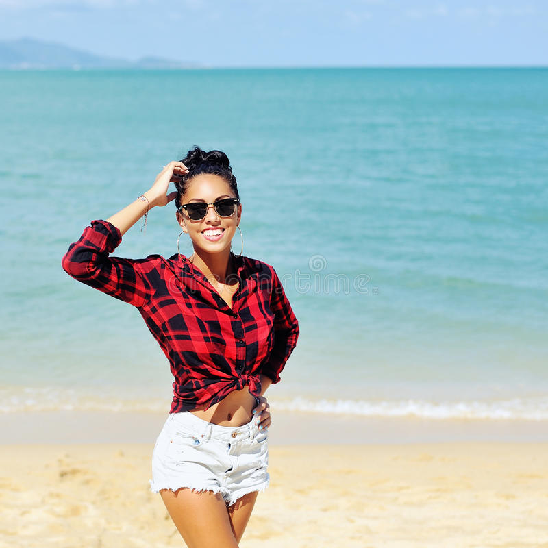 Pretty young woman posing by the sea royalty free stock photo