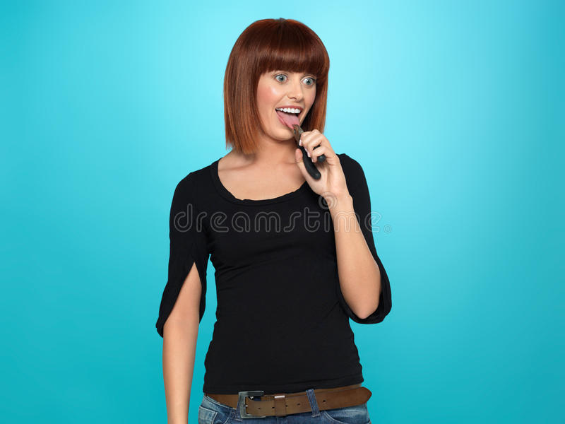 Pretty Young Woman Pulling Her Tongue Stock Photography