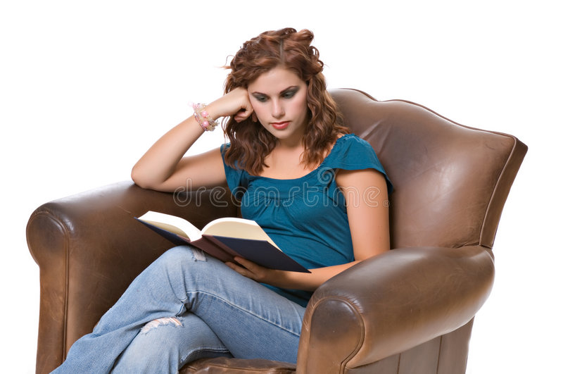 Pretty young woman reading book stock images