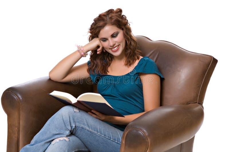 Pretty young woman reading book stock photos