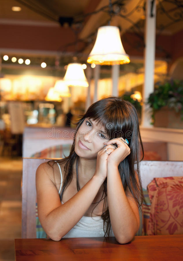 Pretty Young Woman in Restaurant royalty free stock photos