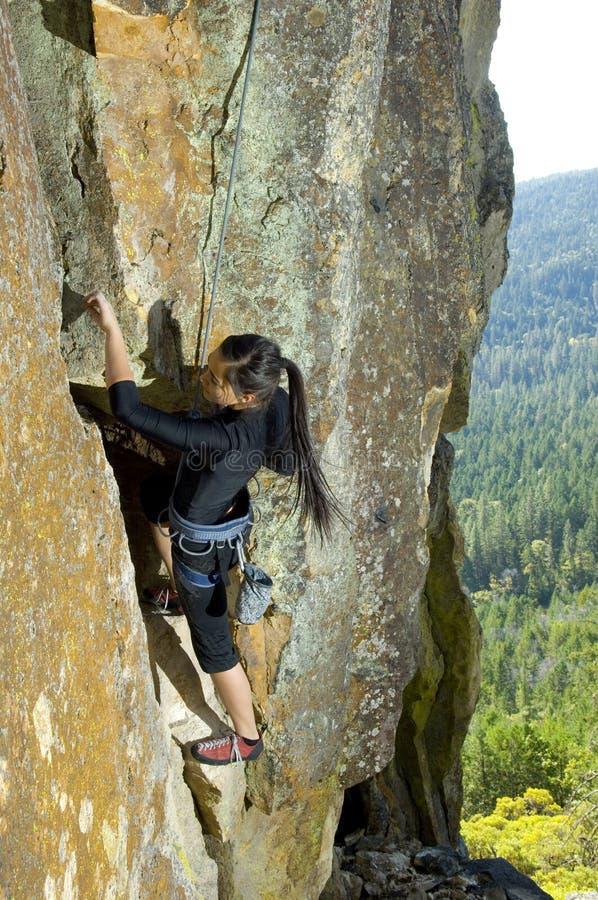 Pretty Young Woman Rock Climbing stock photos