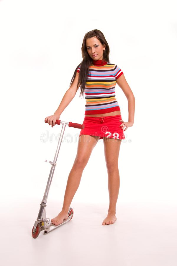 Pretty young woman with scooter royalty free stock images