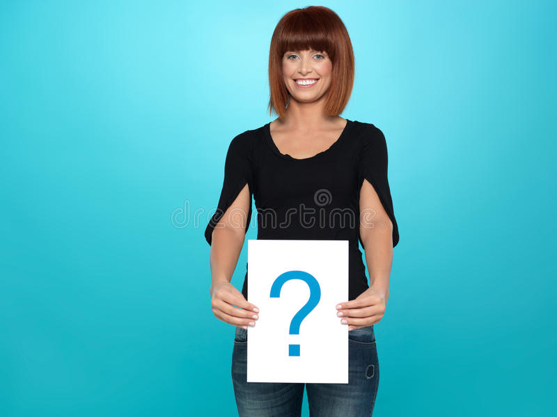 Pretty Young Woman Showing A Question Mark Stock Images