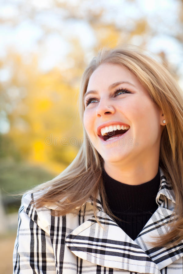 Pretty Young Woman Smiling in the Park royalty free stock image