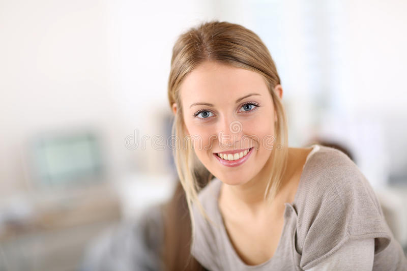 Pretty young woman smiling royalty free stock image