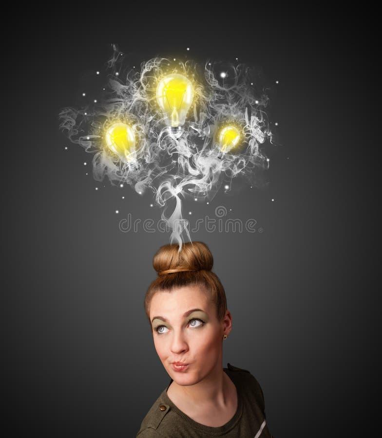 Thoughtful woman with smoke and lightbulbs above her head. Pretty young woman with smoke and lightbulbs above her head stock image