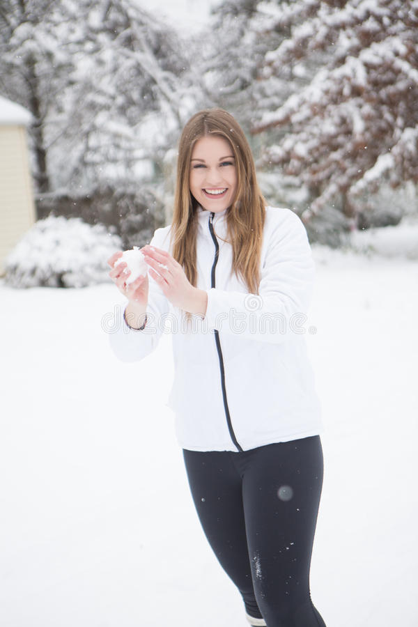 Download Pretty Young Woman With A Snow Ball. Stock Photo - Image: 83720664