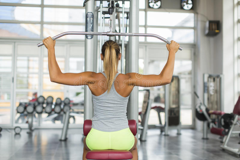 Pretty young woman training in the gym royalty free stock photos