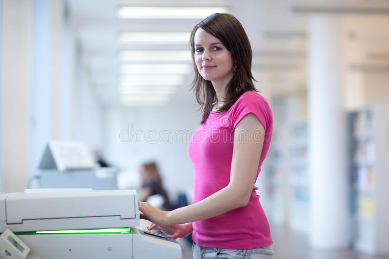 Pretty Young Woman Using A Copy Machine Stock Photos
