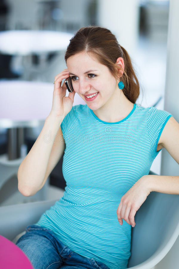 Download Pretty Young Woman Using Her Mobile Phone Stock Photo - Image: 26325830