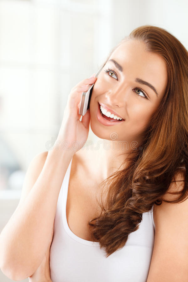 Download Pretty Young Woman Using Mobile Phone Stock Photo - Image: 26046540