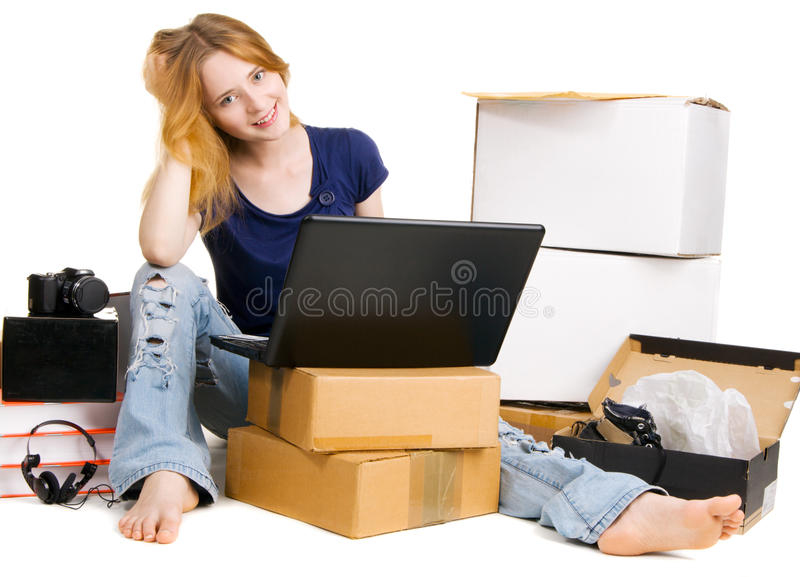Pretty young woman using online stores royalty free stock photo