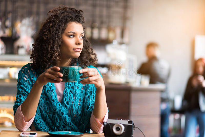 Pretty young woman waiting for someone in cafe stock photos