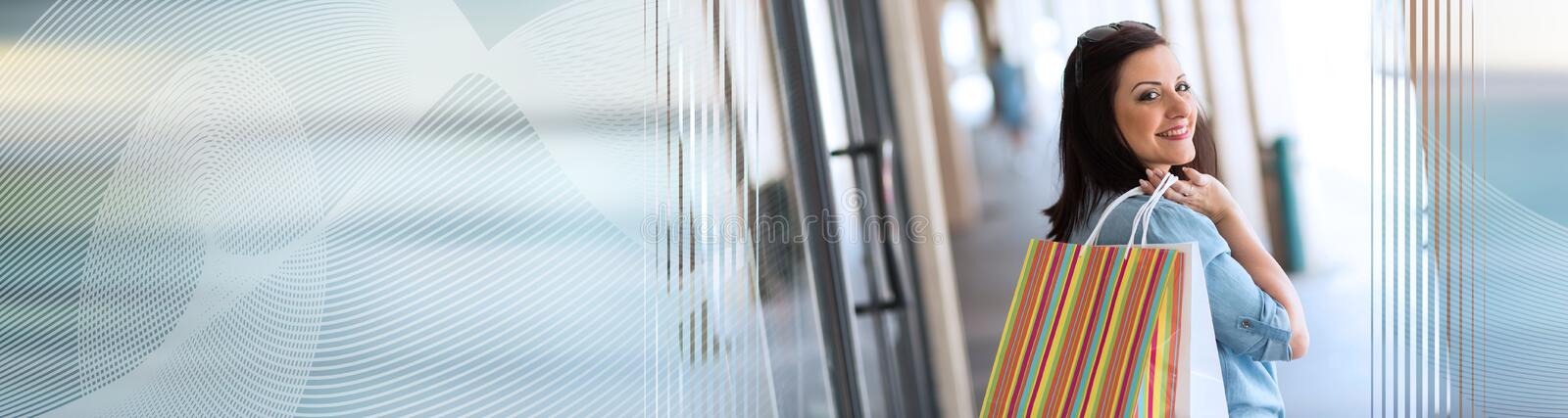Young woman walking with shopping bags in hand. panoramic banner stock images
