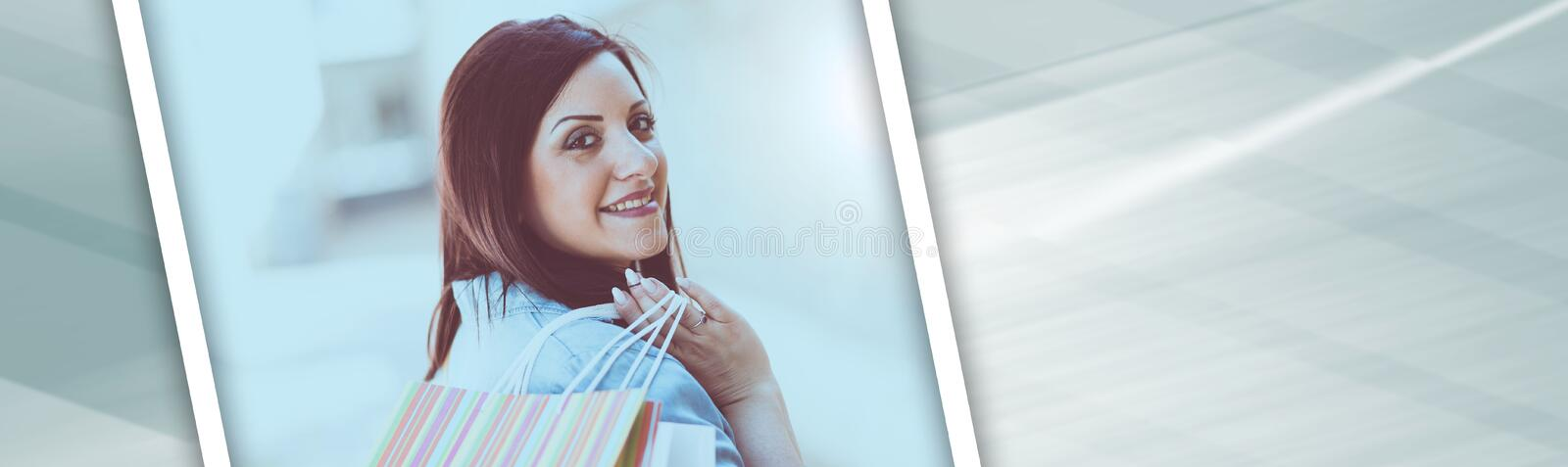 Young woman walking with shopping bags in hand, panoramic banner stock photo