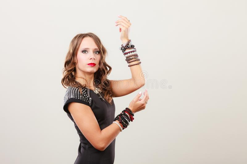 Woman with jewellery in black evening dress royalty free stock photography