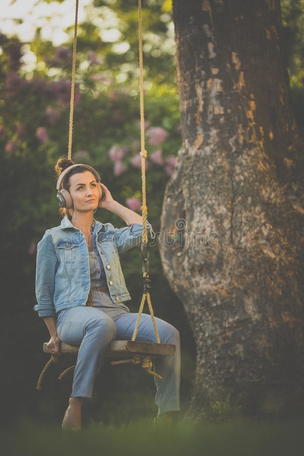 Free Pretty, Young Woman With Headphones Outdoors Royalty Free Stock Photography - 166591427