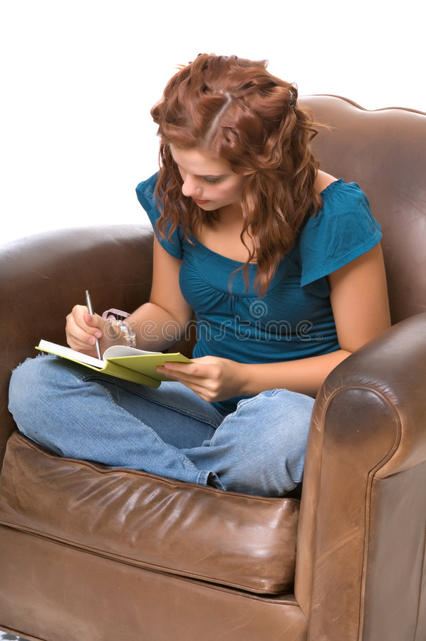 Pretty young woman writing stock image