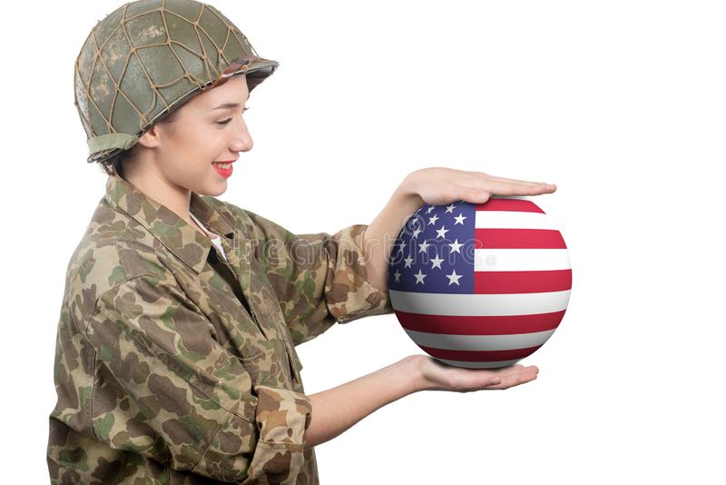 Pretty young woman in ww2 uniform us showing sphere of American flag. A pretty young woman in ww2 uniform us showing sphere of American flag royalty free stock images