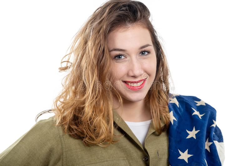 Pretty young woman in wwii uniform us with american flag. Pretty young woman in wwii uniform us with an american flag stock images