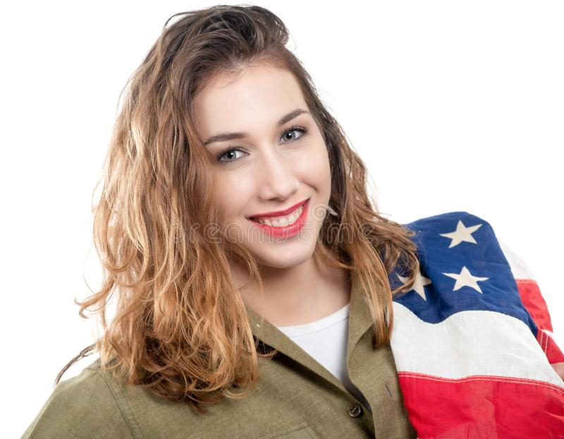 Pretty young woman in wwii uniform us with american flag. Pretty young woman in wwii uniform us with an american flag on white stock photos