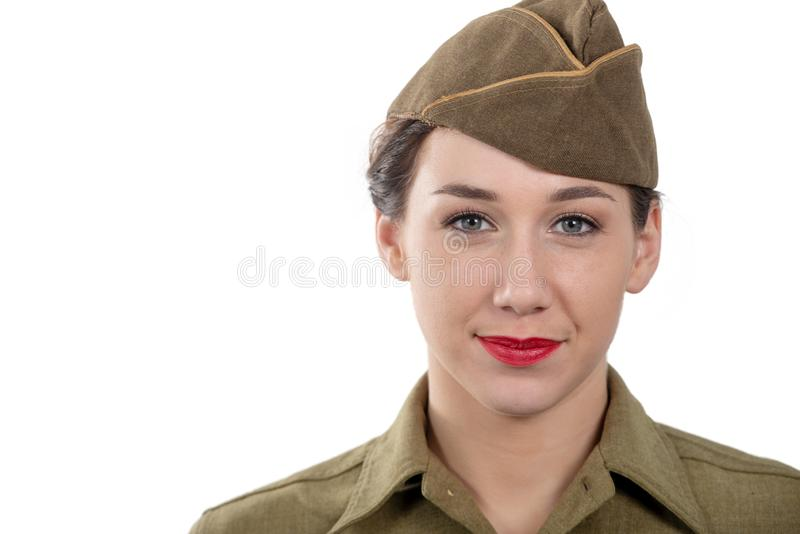 Pretty young woman in wwii uniform us with garrison cap on white background. A pretty young woman in wwii uniform us with garrison cap on white background stock image