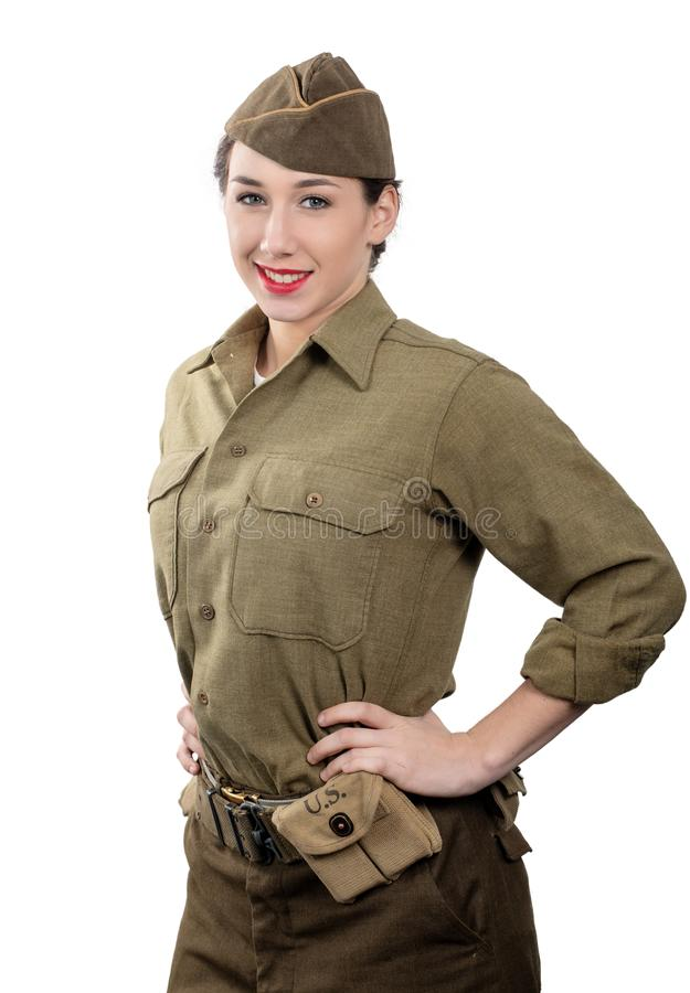 Pretty young woman in wwii uniform us with garrison cap on white. A pretty young woman in wwii uniform us with garrison cap on white background stock photo