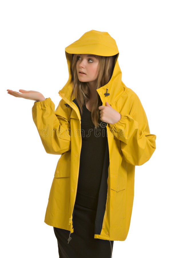 A pretty young woman in a yellow raincoat royalty free stock photo
