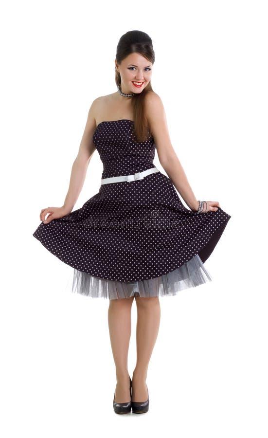 Prettyl womanl im Retro- Kleid stockfotografie