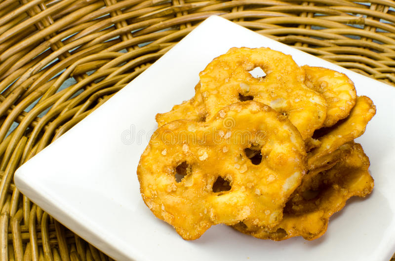Pretzel crackers on bamboo tray. Close up (pretzel, cracker, baked stock image