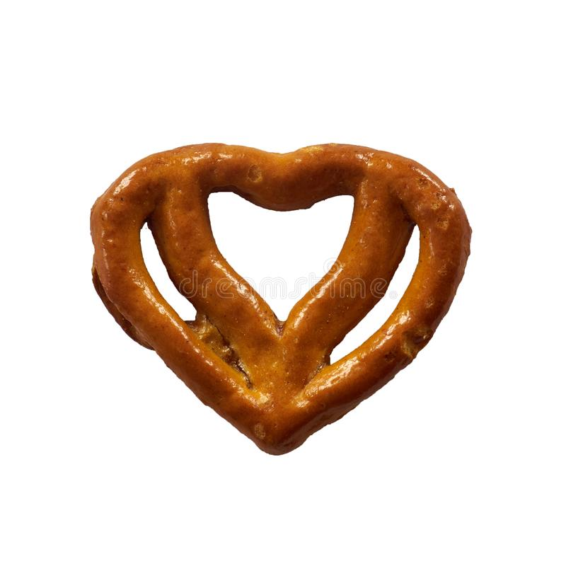 Pretzel in heart shape isolated on white background stock photos