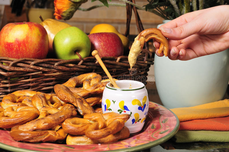 Pretzel with mustard dip royalty free stock images
