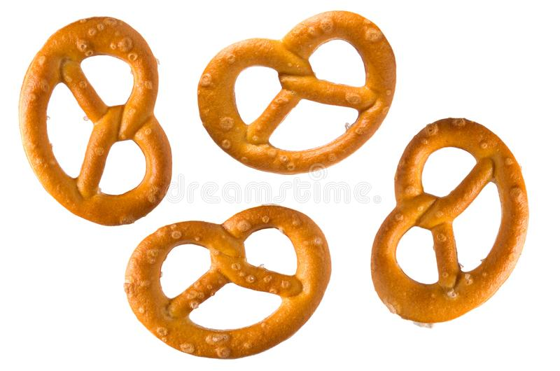 Pretzel with salt. Set or collection of baked pretzels with salt isolated on white background. Snacks for beer stock image