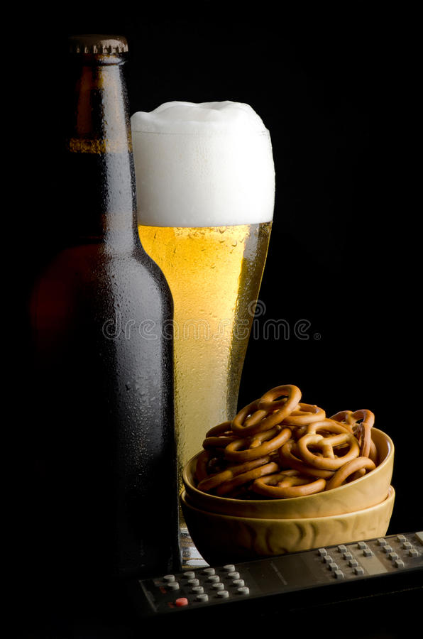 Pretzels with beer and remote control stock image