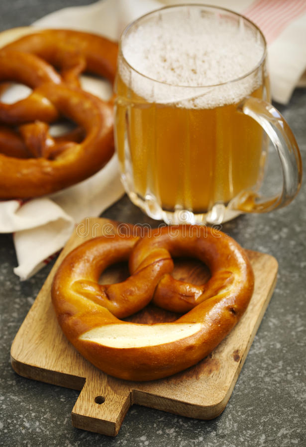 Pretzels and glass of beer stock image