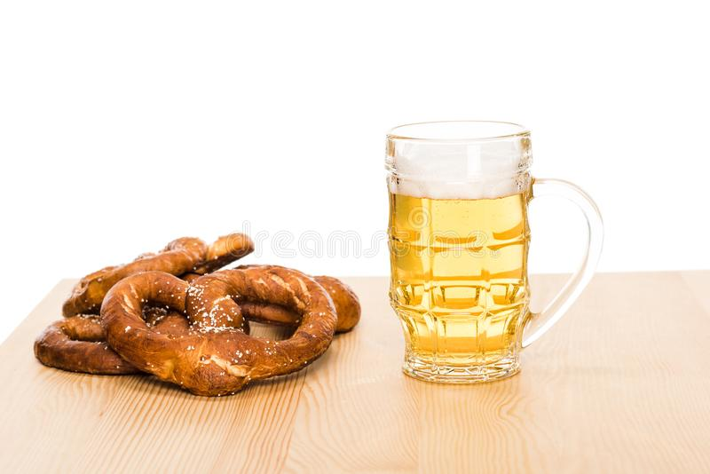Pretzels and glass of beer stock photography