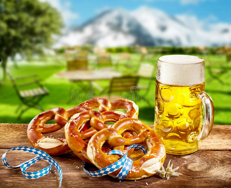 Pretzels and pint of beer to celebrate Oktoberfest royalty free stock images