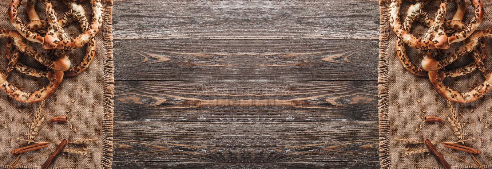 Pretzels with seeds and spice of wheat on rustic textile. Double mirror effect, top view and copy space.  royalty free stock photo