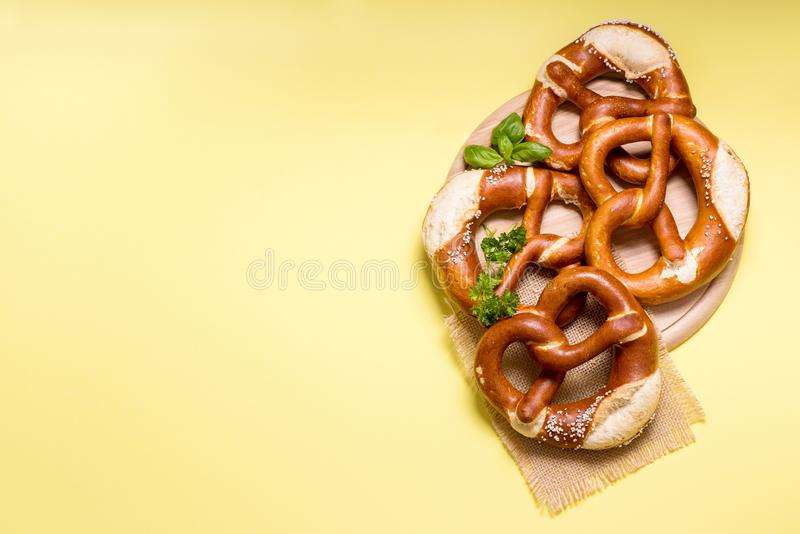 Pretzels on yellow background copy space, german traditional food stock photography