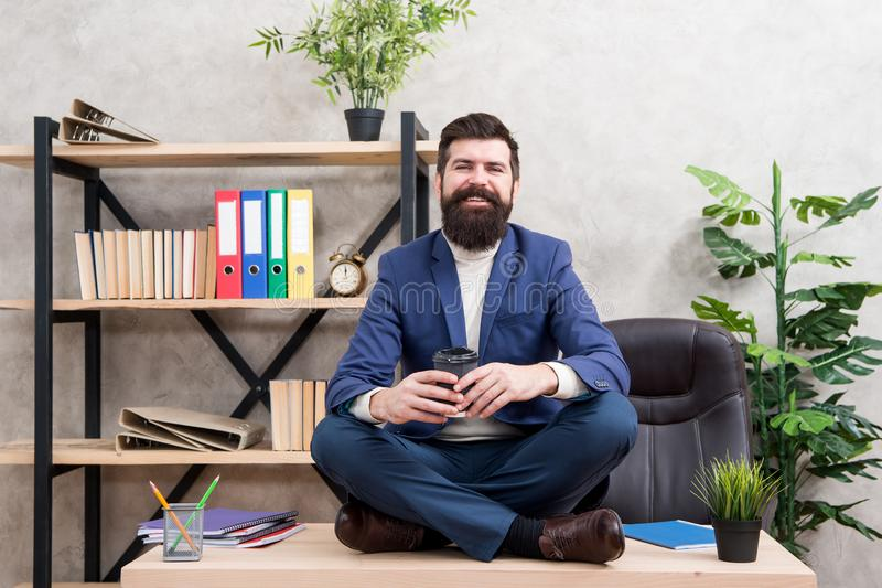 Prevent professional burnout. Way to relax. Meditation yoga. Relaxation techniques. Mental wellbeing and relax. Man. Bearded manager formal suit sit lotus pose royalty free stock image