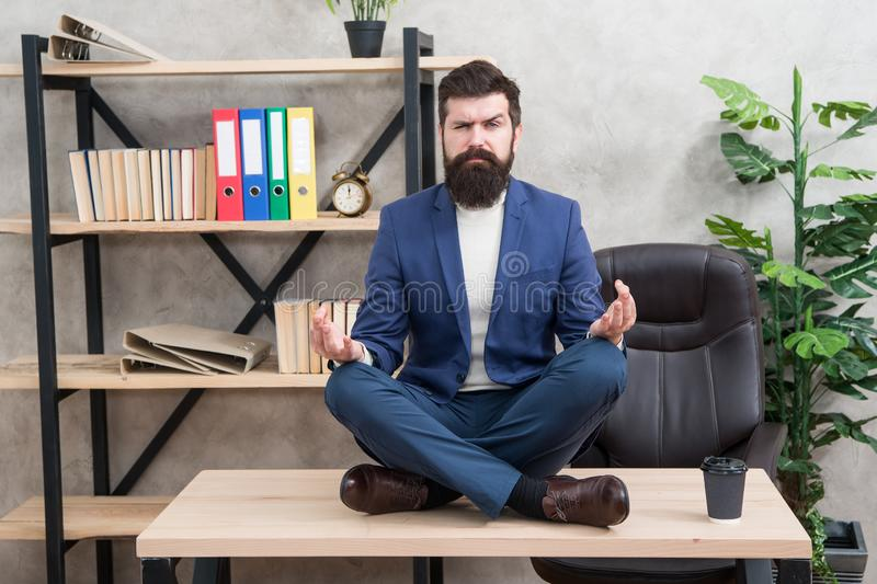 Prevent professional burnout. Way to relax. Meditation yoga. Self care. Psychological help. Relaxation techniques. Mental wellbeing and relax. Man bearded royalty free stock image