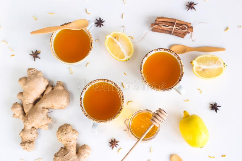 Preventing colds with vitamins. Tea with turmeric among products for improving immunity and treating colds - ginger, lemon, honey, anise. Top view, flat lay royalty free stock image