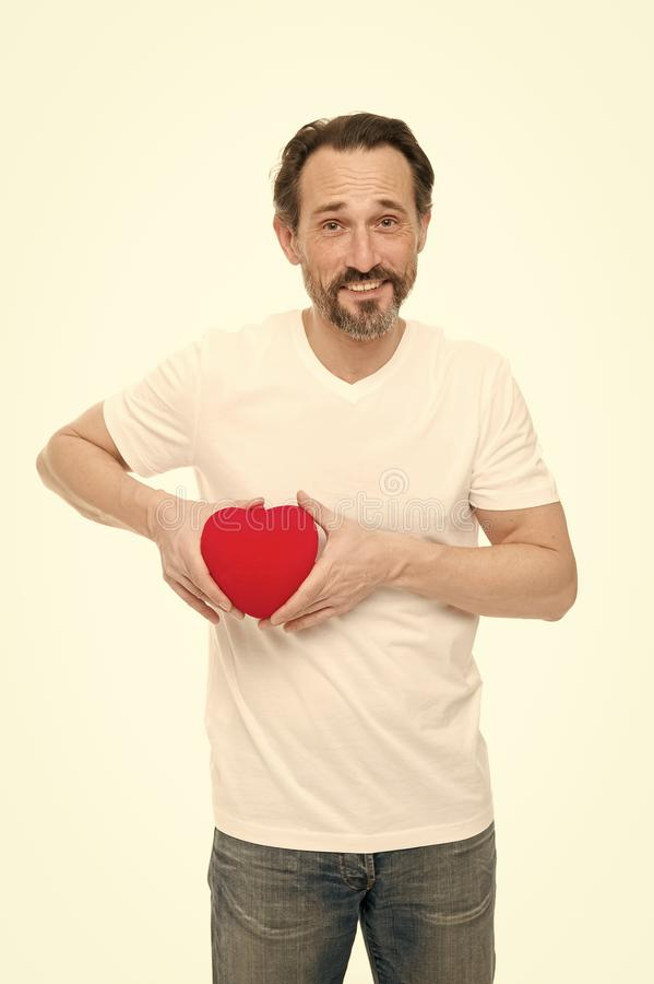 Preventing heart attack. Valentines man holding red toy heart in hands. Handsome mature man with valentines day heart royalty free stock photos