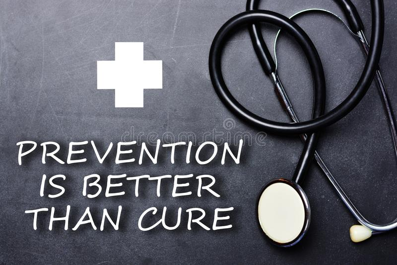 Prevention is better than cure text on chalkboard near medical object and symbols royalty free stock images